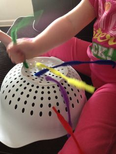 Pipe cleaners and a colander! My two year old loves this and it helps work her fine motor skills and hand eye coordination.