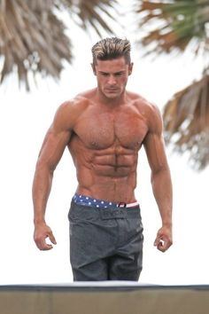 Zac Efron shows off his amazing abs on a Lifeguard obstacle course on the set of 'Baywatch' in Miami