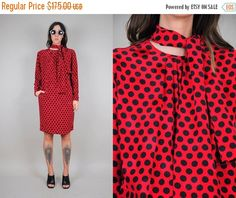 This piece is part of our Abby Mills x Noirohio collection ▸▸▸▸▸▸▸▸▸▸▸▸▸▸▸▸▸▸▸  Vintage 80s Ungaro tent dress. Bold red & black polka dot silk material. Open shape with pockets. Buttons at the neckline with ascot sash tie detail. Please see measurements for fit. We only have ONE of each item.  ✂ - - - MEASUREMENTS: (all were taken while laying flat)  B R A N D : Ungaro B U S T : 23.5 W A I S T : 21 L E N G T H : 38 S H O U L D E R : 15.5 H I P S : 19.5 S L E E V E : 22.5 F A B R I C : silk…