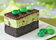 Mint Chocolate Chip Mousse Brownies - fudgy brownies topped with light and fluffy mint chip mousse!   From SugarHero.com