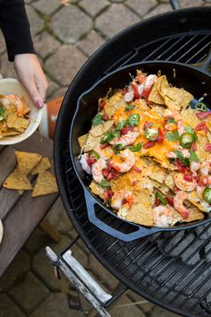 What's your favorite tailgate food? These Shrimp Nachos with Roth Cheese might be your next go-to.