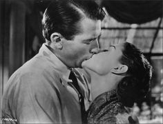 "Great on screen couples - Gregory Peck (1916 - 2003) and Audrey Hepburn (1929 - 1993) kissing in the film ""Roman Holiday,"" directed by William Wyler."