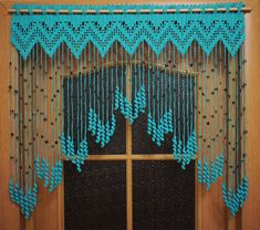 Beaded curtains, Crochet door curtains Hearts with acrylic beads and tassels, orange door curtains, crochet lace curtainsCrochet curtain on the doorway Tenderness, a turquoise curtain with coconut beads Crochet Curtain Pattern, Crochet Curtains, Curtain Patterns, Curtain Designs, Curtain Ideas, Filet Crochet, Crochet Diagram, Crochet Stitches, Beaded Door Curtains