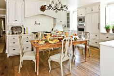 Country Home Kitchen - 110 Beautiful Kitchens - Southernliving. A rustic farm table takes the place of a central island in the kitchen, giving the homeowner a spot for casual meals.  See more of this Town and Country Home Renovation