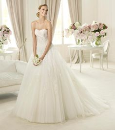 Pronovias Planeta -- more dramatic than the Pergola (wider skirt) and no ruched bodice
