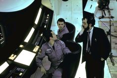 Actors Keir Dullea and Gary Lockwood listen to Stanley Kubrick on set of 2001: A Space Odyssey. By Dmitri Kessel.