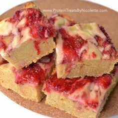 Strawberry Cheesecake Protein Blondies! Sweet Strawberry Topping: 2t lemon juice, 1C diced strawberries, 3T granulated stevia. Soft Blondie: (dry) ½C coconut flour, 1C oat flour, 2 scoops protein powder of choice, 6T granulated stevia, ½t baking powder. (wet) ¼C melted coconut oil, ½C SF maple syrup, ½C almond milk, 1t vanilla, 1t butter extract, 1 large egg. Creamy Cheesecake Topping: ¼C cottage cheese, ½ scoop protein powder of choice, 1 egg white