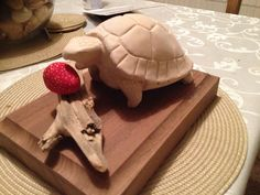 The tortoise and the strawberry. Follow me at www.cutmarks.co.uk