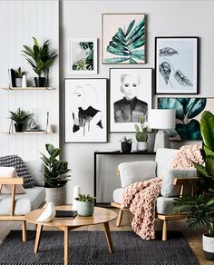 How to buy art online and great ideas for displaying it in your home. We look at the top 3 ways to display art and prints, from gallery walls to using contrasting paint colours. Plus ideas from what art to buy, from limited edition prints to originals affordable art. Pretty botanical inspired gallery wall in a modern Scandinavian style living room with chunky knitted pastel pink blanket and grey rug.