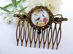 Romantic hair comb with bird cage and roses by Schmucktruhe, €16.50