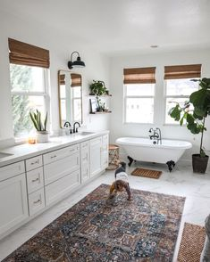 When choosing bathroom window treatments, style can be a big factor, but also make sure you select a material that will hold up against high humidity. Bathroom Window Treatments, Bathroom Blinds, Bathroom Windows, Master Bathroom, Bathroom With Window, Clawfoot Tub Bathroom, Relaxing Bathroom, Woven Wood Shades, Bamboo Shades