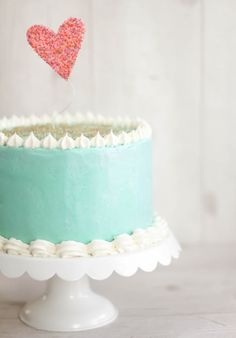 A Week's Worth of Wedding Inspiration! Cute cake!  subtract the heart for a seascape wedding.
