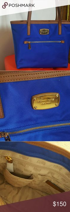 Purse This royal blue with envy Michael Kors handbag is absolutely gorgeous . this staple piece really could make any outfit pop ! As you can see the inside and outside are both very clean and has no wear and tear ! :) Michael Kors Bags