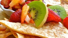 This delicious salsa made with fresh kiwis, apples and berries is a sweet, succulent treat when served on homemade cinnamon tortilla chips. Enjoy it as a summer appetizer or an easy dessert.