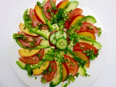 Summer on a plate :-) thinly sliced avocado, nectarine, tomato with chopped spring onions and cilantro