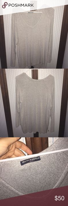 Brandy Melville Grey Sweater Really good condition, very slight fuzzing but hardly noticeable unless you look closely - worn only a few times - one size - very cute and comfortably- it is Brandy, such amazing material and so trendy - price is negotiable, just make a reasonable offer Brandy Melville Tops