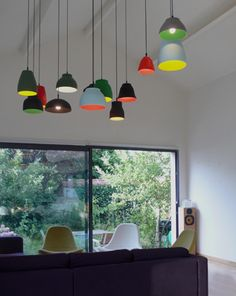 'The grape fruit' is a collection of pendant lamps hand-made from earthenware. Each of the 13 lamps is a different colour inside and out, and each was hand-thrown instead of cast. The lamps also each have different forms and sizes arnold goron / the grappe fruit light http://arnoldgoron.com