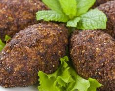 How to make Kibbeh. Easy and simple Kibbeh Recipe. A Levantine dish that resembles a fried croquette made of cracked wheat, spices, and herbs, stuffed with minced beef or lamb. Lebanese Cuisine, Lebanese Recipes, Asian Recipes, Ethnic Recipes, Vegetarian Recipes, Cooking Recipes, Healthy Recipes, Arabian Food, Love Food
