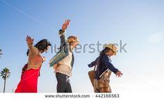 Friends balancing, walking in line - Shutterstock Premier