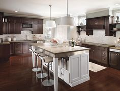 High Gloss White Shades And Aluminum Trim Accents Make This Kitchen