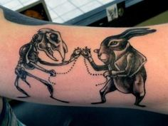 Portrays the fragility of life and death and how we are all running against time. And rabbits are kick ass.  Done by THE Chad Lenjer at Black Metal Tattoo Company in Strongsville, OH.