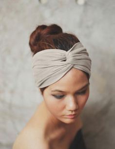 Here is a tutorial that takes less than 5 minutes to complete. It is a clever way to recycle your old tees to make headbands for your future workouts. These turban style headbands also double as wonderful working sweatbands! Here is what you'll need: An old tee.
