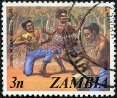 Dancers of the national dance troupe,  stamp printed in the Zambia , circa 1980s.