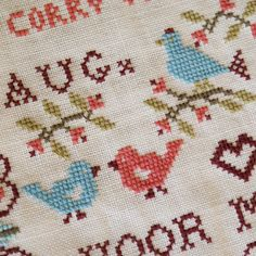 Cross Stitch quilt label by dutch blue, via Flickr