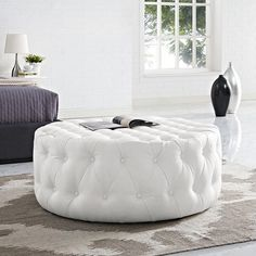Description Take your living room style to a new level with the Modway Amour Upholstered Vinyl Ottoman. Fashionably chic, this round ottoman features fine vinyl