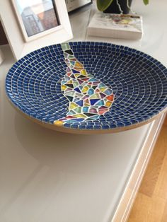 A bamboe dish, 30 cm . MAde with glass mosaic and glass drops.This bowl is in stock In different colours available. Ask me by mail.