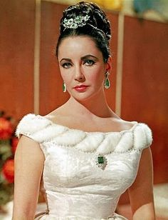 Elizabeth with some of her emerald and diamond jewel: the Bulgari brooch as a hair decoration, a pair of earrings and a smaller brooch on front of her dress.