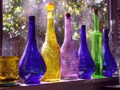 It is amazing all the different looks and feels you can get just by using decorative bottles and jars. Here are some amazing way you can use glass bottles and jars. Colored Glass Bottles, Glass Vials, Bottles And Jars, Mason Jars, Perfume Bottles, Coloured Glass, Colored Vases, Water Bottles, Bottle Trees