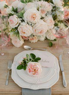 Ivory dinnerware covered in blush roses: http://www.stylemepretty.com/2016/11/02/flutter-magazine-lauren-conrad-maura-oehm-paper-crown/ Photography: Jose Villa - http://josevilla.com/