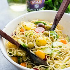 Packed with fresh summer veggies, STAR Olives & feta cheese, this delicious recipe for Spaghetti Salad is perfect for all your summer picnics!