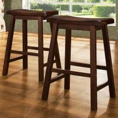 @Overstock.com.com - These Salvador stools features a saddle back design in