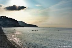 The sun is momentaly obscured by a cloud which allow us to see the sunlight who warm up the breav early swimmers.