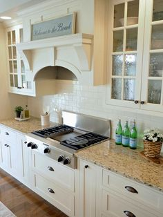 Ivory Kitchen cabinet paint color and backsplash. The Sherwin Williams paint color closely matching to the cabinet paint color is Dover White #SW6385. The off-white subway tiles are slightly irregular cut with an uneven surface. Home Bunch Beautiful Homes of Instagram wowilovethat