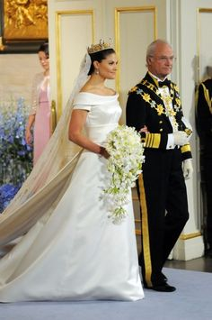Crown Princess Victoria of Sweden with her father, King Carl Gustaf, on her wedding day.