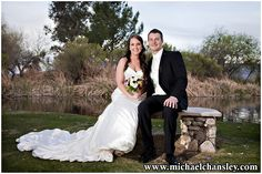 Bride and Groom pose for a formal portrait at La Mariposa Resort wedding venue in Tucson AZ Arizona by Michael Chansley Photography wedding photographer Tucson ideas grass lake pond sunset