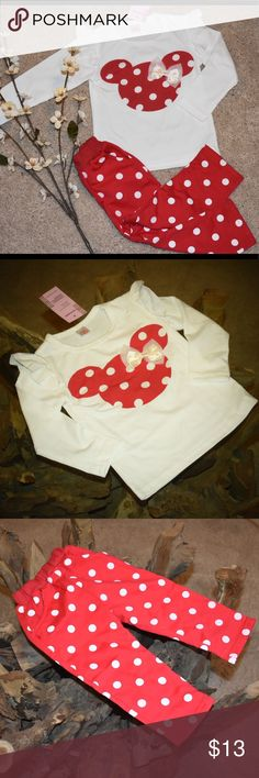 Minnie Mouse red polka dot outfit White shirt with ruffled shoulders sewn on red polkadot Minnie mouse cut out with White ribbon bow. Pants are red polkadot that match the shirt with functional pockets and drawstring. Size 9 months Matching Sets