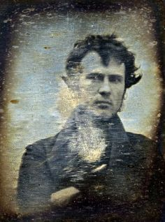"Robert Cornelius's self-portrait, one of the earliest known photographs of a human being, taken nearly 200 years ago. The back reads, ""The first light picture ever taken."""