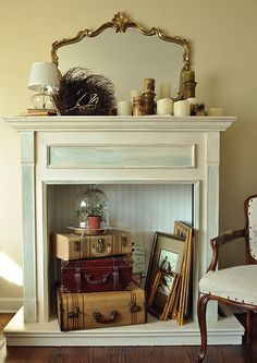 Old suitcase fireplace decor