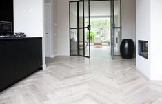 I love the contrast of the herringbone floor with the strong lines of the steel doors Style At Home, Interior Architecture, Interior And Exterior, Luxury Flooring, Wood Flooring, Hardwood Floor, Home Fashion, Interior Design Inspiration, Interior Styling