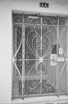Pretty rod iron decor like this for Kiano's door. Minus the huge lock. haha