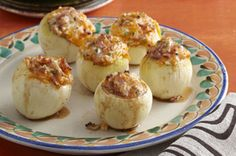 Looking for a summer side dish that will really impress? This savory recipe for Grilled Onions stuffed with bacon, cheese and serrano chiles is sure to wow any BBQ crowd.