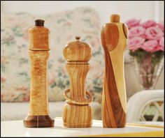 Pepper mill trio, quilted maple with segmented base, ash with trapped ring, triple slant laminate
