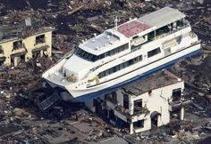 ferry on a roof top - 2011 Japan Earthquake and Tsunami Left 20,000 dead