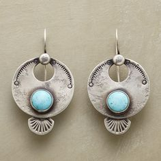 """CIMARRON EARRINGS -- Handstamped sterling silver disks set with turquoise hang from sterling wires in these timeless earrings by Southwestern artist Dennis Hogan. USA. Exclusive. 2""""L."""