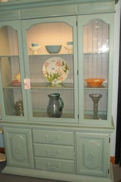 my old bathroom china cabinet painted black with taupe insides ...