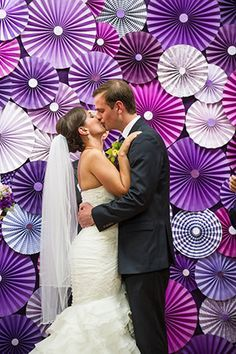 shade of purple paper fans back ground for wedding aisle and wedding pictures